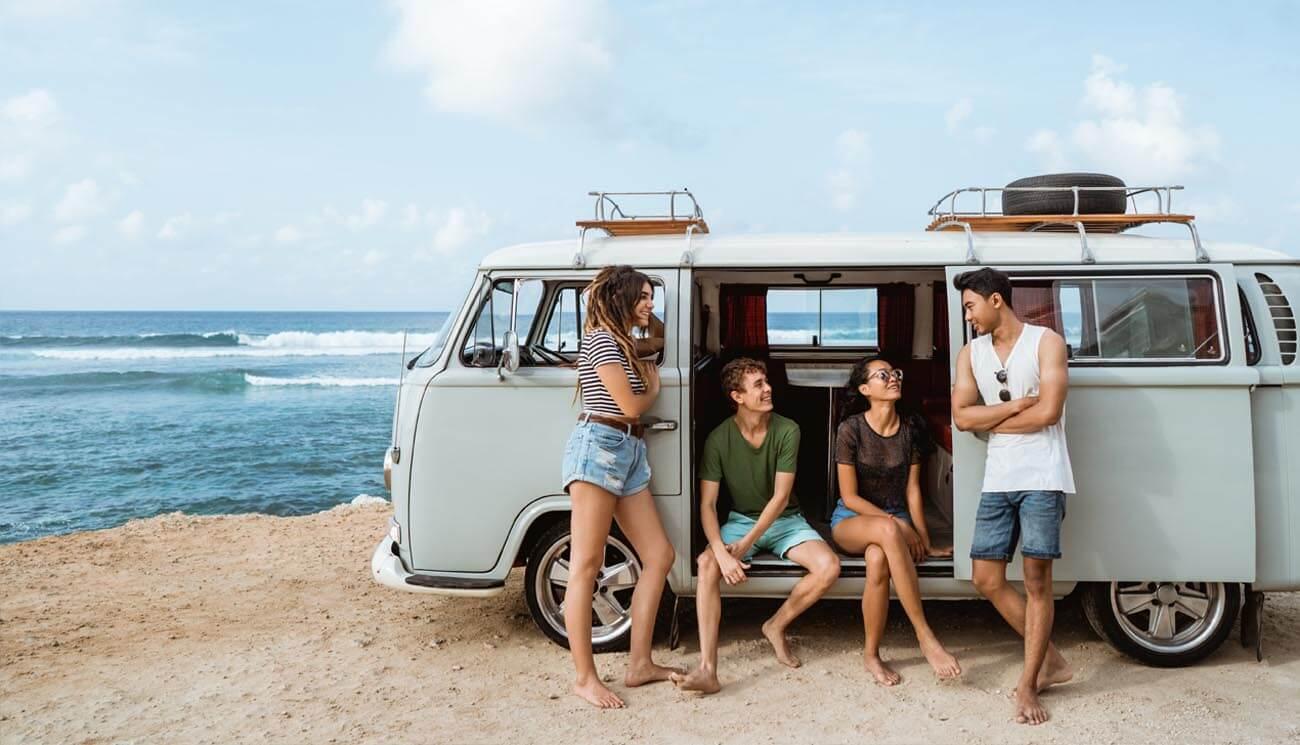 Friends sitting in a van