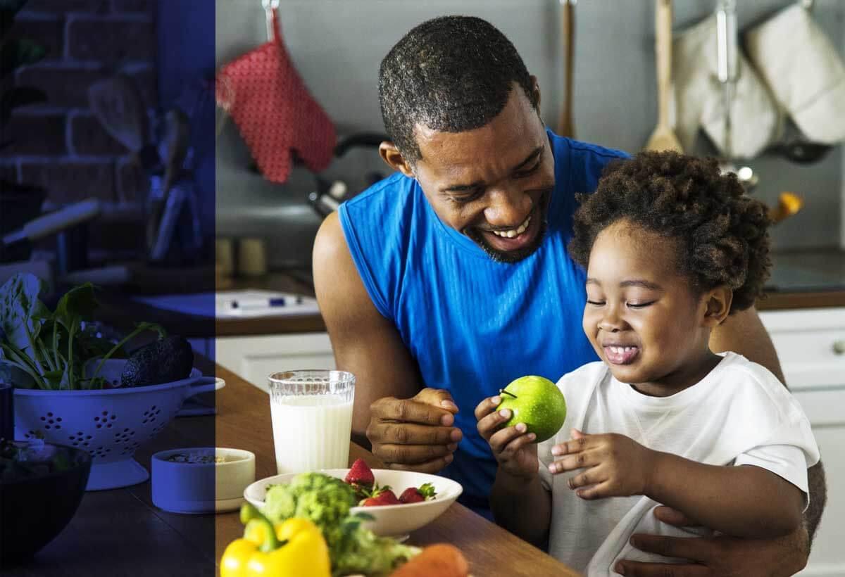 Metropolitan Life - Father & Child in Kitchen